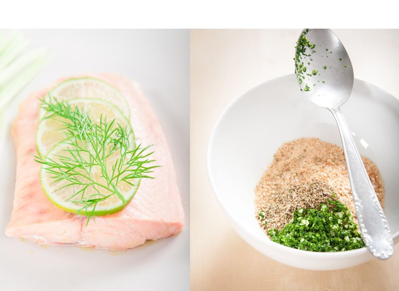 A wild salmon fillet with lime slices and a fennel leaf and breadcrumbs with parsley and garlic